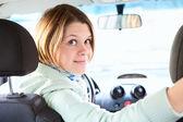 Joyful woman inside of car looking back — Stock Photo