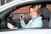 Portrait of female driver with car key — Stock Photo