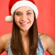 Young beautiful woman in Santa`s hat — Stock Photo #1584285