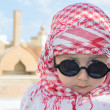 Royalty-Free Stock Photo: Little girl in sunglasses and shawl