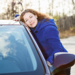 Joyful girl embracing car standing in sun lights — Stockfoto #15857637