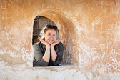 Caucasian woman in ancient wall loophole cheerful and happy — Stock Photo