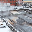 Evaporation on sewage treatment plant in winter season — Stock Photo