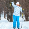 Happy woman on cross ski riding on snow — Stock Photo