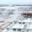 Snow-covered aeration wastewater tanks in sewerage treatment plant — Stock Photo #18881555