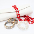 Golden braceletes, red necklace with purse on white background — Stock Photo #18881559