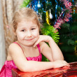 Royalty-Free Stock Photo: Small girl portrait with gifts near Christmas tree