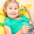 Little Caucasian child with digital tablet pc on bed — Stock Photo