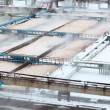 Snow-covered aeration wastewater tanks in sewerage treatment plant — Stock Photo