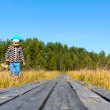 Caucasian small child walking in swamp — Stock Photo