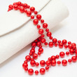 Red pearl necklace with purse on white background — Stock Photo
