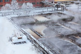 Aeration basin with evaporation in winter season in water treatment plant — Stock Photo