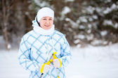 Happy young woman standing on ski with poles in hands — Stock Photo