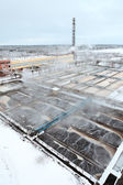 Covered with snow sewage treatment plant — Stock Photo