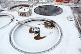 Four circular settler on industrial sewage treatment plant in winter season — Stock Photo