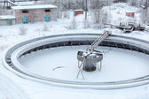 Covered with snow empty big settlers in sewerage treatment plant — Stock Photo