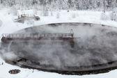 Evaporation in sewage settlers in winter season — Stock Photo