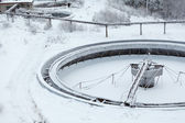 Old snow-covered empty round settler in sewerage plant — Stock Photo