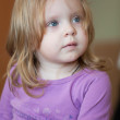 Picture of pensive small girl with blue eyes and blond hair — Stock Photo