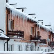 Overhanging icicles on the house roof over balconies — Stock Photo #21257473