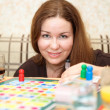 Caucasian woman playing board games in domestic room — 图库照片