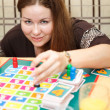 Caucasian young woman playing board games in domestic room — 图库照片