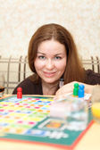 Caucasian woman playing board games in domestic room — Stock Photo