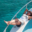 Постер, плакат: Woman with beautiful legs on a yacht