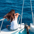 Rear view of girl on a yacht - Stock Photo