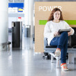 Woman with electronic devices near place to charge your phone. Copyspace — Stock Photo