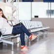 Stock Photo: Tired transit passenger sleeping in airport lounge