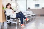 Cheerful joyful Caucasian woman spending time in airport lounge — Stock Photo