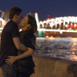 Stock Photo: Romantic couple kissing near river at night