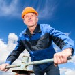 Stock Photo: Senior Caucasiworker in hardhat at factory with pipe valve against blue sky