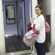 Stock Photo: Attractive woman a passenger with bags boarding in express from airport