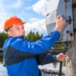 Caucasian senior worker with electric shock then turning the power switch — Stock Photo