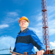 Stock Photo: Senior Caucasimin working uniform with pipe valve. Looking fare away