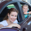 Happy Caucasians mother and young child waving from vehicle windows — Stock Photo