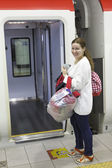 Attractive woman a passenger with bags boarding in express from airport — Stock Photo