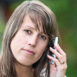 Caucasian women calm face close-up with mobile phone — Stock Photo