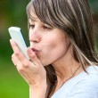Caucasian young woman kissing cell phone outdoor — Stock Photo