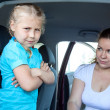 Caucasigirl does not want fastening in child safety seat in car — Stok Fotoğraf #29473899