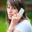 Caucasiyoung womtalking on cell phone outdoor — Zdjęcie stockowe #29473963