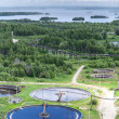 Stock Photo: Water treatment plant in evergreen woods and blue lakes