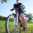 Woman riding bicycle  — Stock Photo
