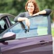 Woman standing near new car  — Stock Photo