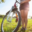 Cyclist with bike — Stock Photo