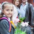 Little schoolgirl with her parents at the school — Foto de Stock