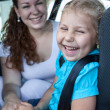 Mother with daughter in a car — Stock Photo