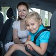 Travelling in car with safety child seat — Stock Photo